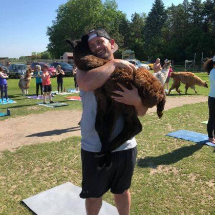 Yoga Man Hugging a Llama